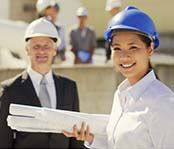Utitility workers wearing a hard hat smiling, male and female