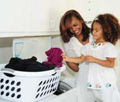 Mother and daughter doing the laundry